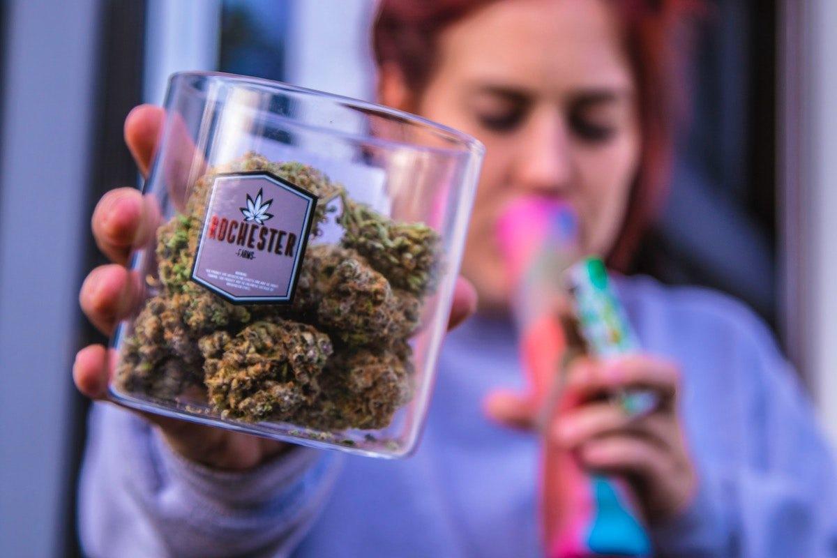 cannabis jar person