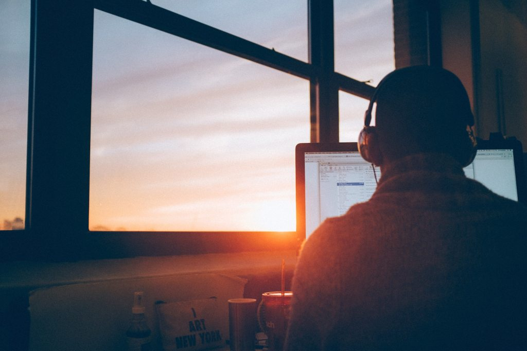 man with a laptop in the sunset