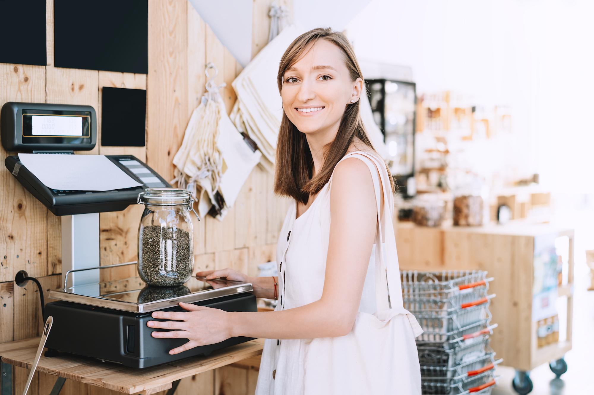 woman-weighs-cannabis-jar